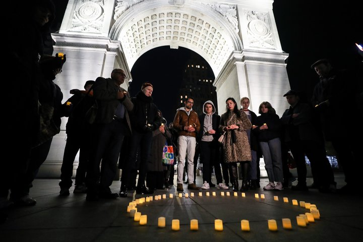 People gather at Washington Square Park in New York during a March 16 vigil held for victims who lost their lives during the
