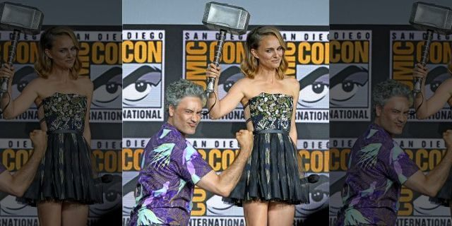 """Director Taika Waititi passes the hammer to Natalie Portman as they announce """"Thor 4: Love and Thunder"""" at San Diego Comic-Con on July 20, 2019. Portman was previously believed to be done with the Marvel franchise."""