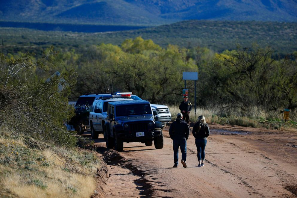 PHOTO: Police officers close the road outside Tonto Creek near Bar X road in Tonto Basin, Ariz., Nov. 30, 2019.