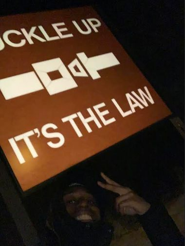 Jaylan Butler posed with a road sign near a rest stop in East Moline, Illinois, moments before police forced him to the groun